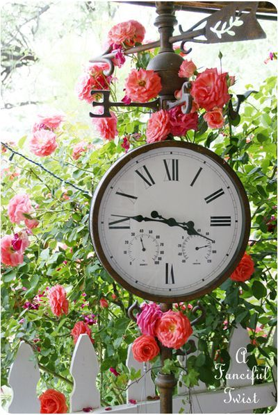 Our new/old clock in the garden...........