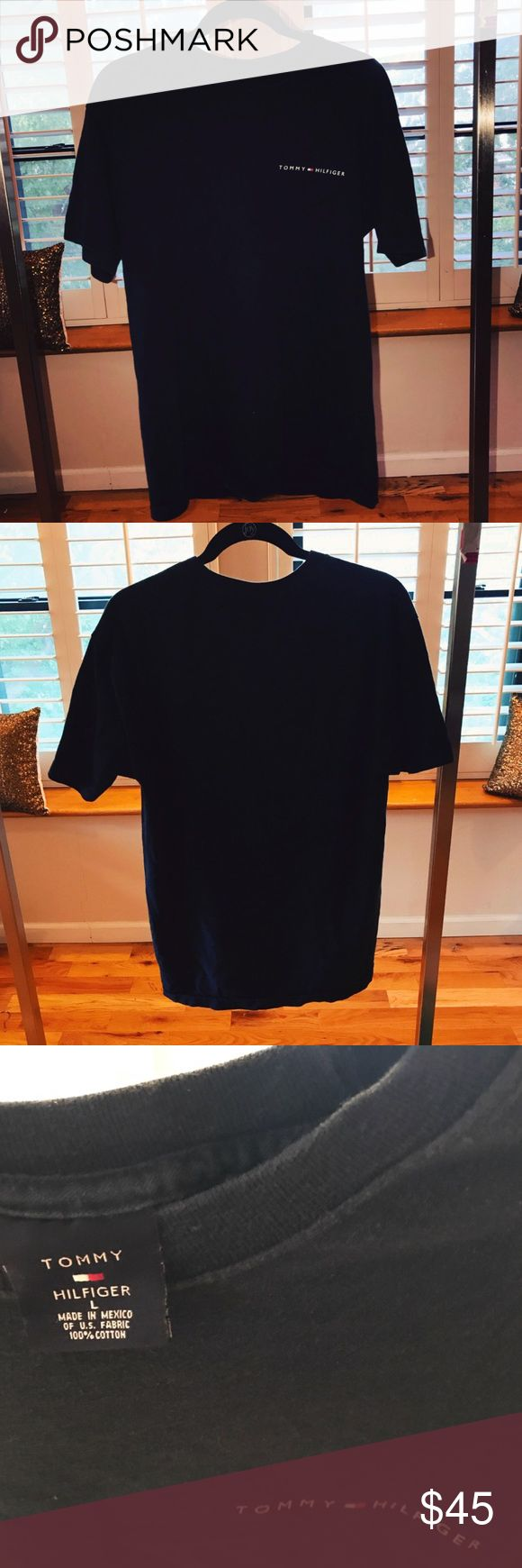 Vintage Navy Tommy Hilfiger T-shirt Worn a little in the neck but not noticeable.. but everywhere else on the tshirt is in great condition Tommy Hilfiger Tops Tees - Short Sleeve