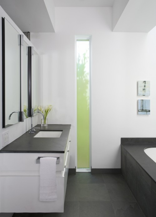 Tall vertical window in bathroom - or horizontal across the top of the wall would be nice too