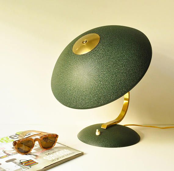 This unique midcentury desk lamp in a very retro cypress green colour has a large shade that can change direction up & down and golden metal arm with a beautiful curved shape. Its most impressive feature apart from its amazing colour and shape is that it carries two lamps and you can choose whether you wish to switch them both or separately just by clicking once or twice the on-off switch on the base of the lighting!  Dimensions: - Height 31 cm - Base diameter 23 cm  - - - - - - - - - - -...