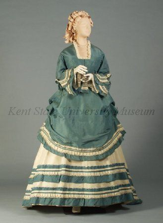 Ensemble Date	1866-1870, ca. Culture	American, attributed Description	Blue, white silk taffeta. Bodice:blue, square neck, pagoda sleeves, white ruffle trim at peplum. Skirt: white taffeta, blue and white ruffle trim. Overskirt: blue, 3/4 length, white trim.