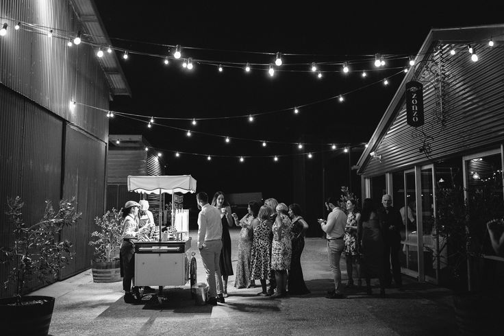 bianco latte ice cream carte, under festoon lights at zonzo estate yarra valley wedding by Vanessa Norris Photography