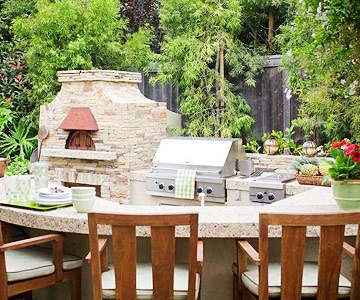 Outdoor Kitchen - full-service kitchen complete with a snack bar, dishwasher, fridge, and wood-burning pizza oven.  Can we say WOW???