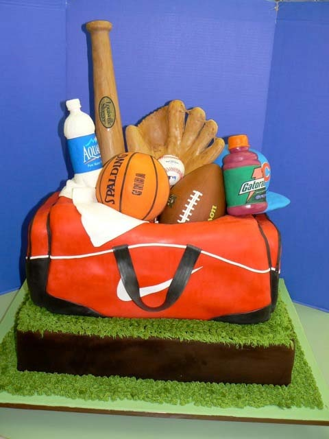 cute sports cake and great example of my mission.. ornate imaginative but extremely expensive and all but the bottom layer inedible