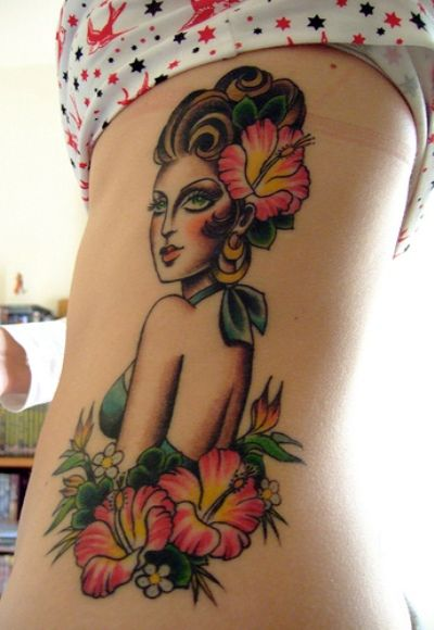 Hula girl Hawaiian tattoo design with hibiscus flowers