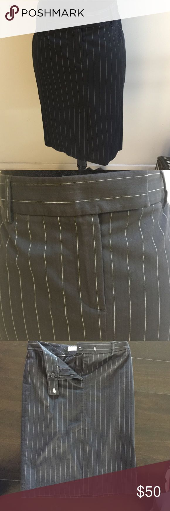 "MassimoDutti Black/white pinstripes Pencil Skirt Massimo Dutti Black with with pinstripes Pencil Skirt. Kick pleat in front. Fully Lined. 62% Cotton, 33% Polyamide, 4% Lycra. Waist is 15"" across and 23"" length. In perfect condition Massimo Dutti Skirts Pencil"