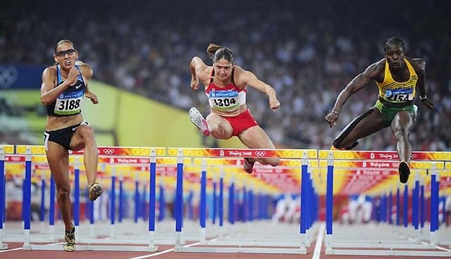 Lolo Jones USA (left), Priscilla Lopes-Schliep CANADA and Delloreen Ennis-London JAMAICA during the 100-metre hurdles semifinals - Beijing 2008