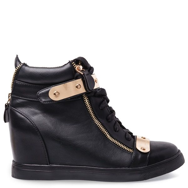 Black sneaker with hidden wedge, gold details and two gold decorative zippers.