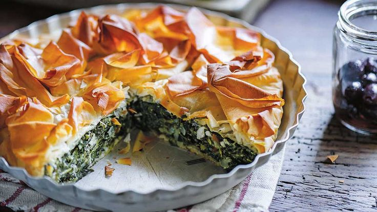 This is a low-fat, rustic take on a traditional Greek spanakopita, with ricotta replacing some of the feta and just one spritz of olive oil on the pie's ruffled top instead of the quite unnecessary – though we'd have to admit, quite delicious – melted butter on every layer. Filo itself is pretty healthy as pastry goes, containing only 3% fat as opposed to up to 50%for puff pastry, making it a perfect Thinner Dinner pie.