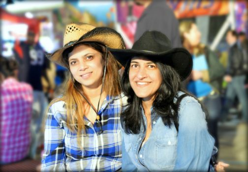 This is one of 20 finalists in the Houston Chronicle's 2014 rodeo photo contest. You can see the rest of the entries and vote for your favorite here: http://www.chron.com/life/article/Houston-Rodeo-Photo-Contest-5270431.php.  My lovely wife, Preeti, and her beautiful friend, Anamika, taking it easy at the rodeo carnival. 17 - Viraj Pikle Photo: Picasa