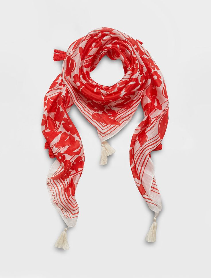 This scarf is made from printed silk. It features a floral pattern from the collection, framed with a border and personalised with a logo. It is adorned with tassels and finished with a hem on all four sides.