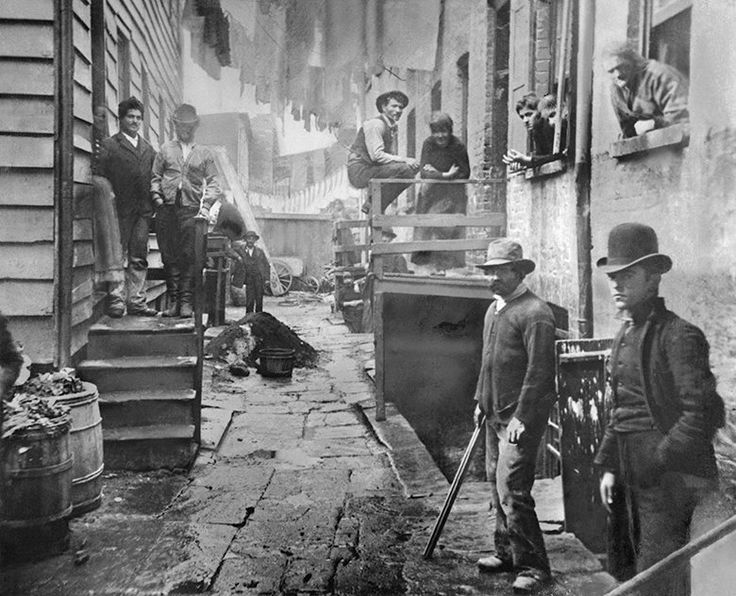Residents of the alley known as Bandit's Roost at 59½ Mulberry Street in New York (ca. 1888). Photo by Jacob August Riis