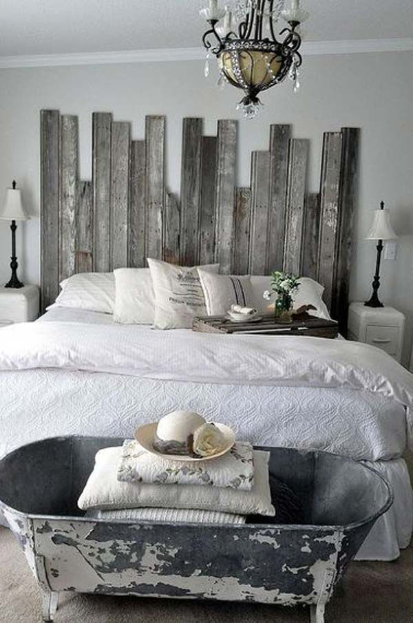 COOL BEDROOM DECOR WITH OLD BATHTUB AT THE FOOD OF THE BED AND PALLET HEADBOARD