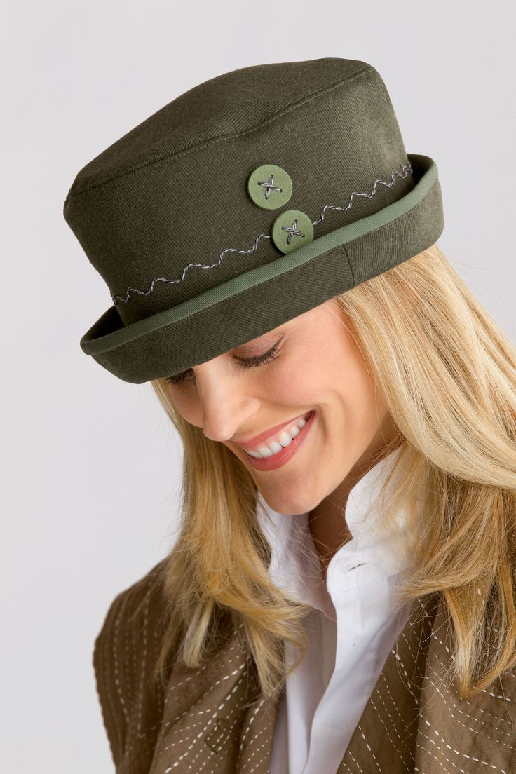 Crusher Hat by Renee Roeder-Earley. Hand-felted buttons and playful stitching detail add an artful flourish to this versatile wool hat. Overview: Artist-made in the U.S.A. Fabric wool Dry clean Sizing: Sizes S (21