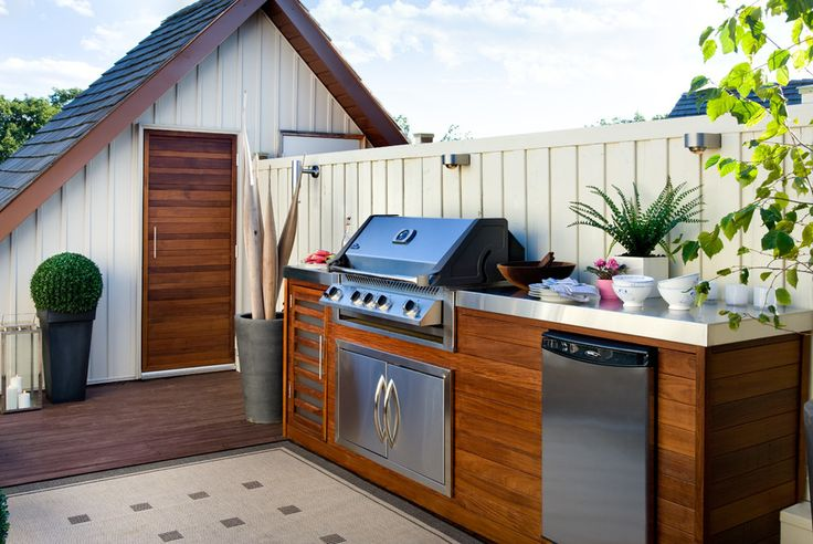 This rooftop kitchen features even a dishwasher. A  subtle lighting system make it a great space for some night entertaining.