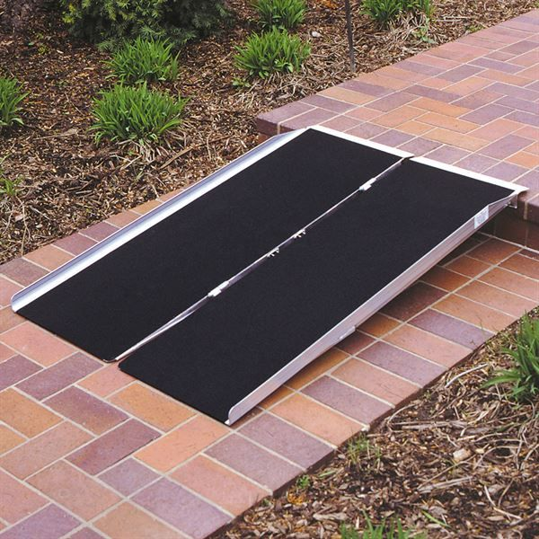 Scooter ramp on a pathway step