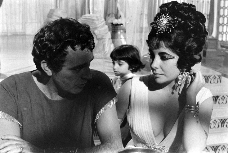Not published in LIFE. Richard Burton, Elizabeth Taylor and Taylor's daughter, Liza, on the set of Cleopatra Rome, 1962.