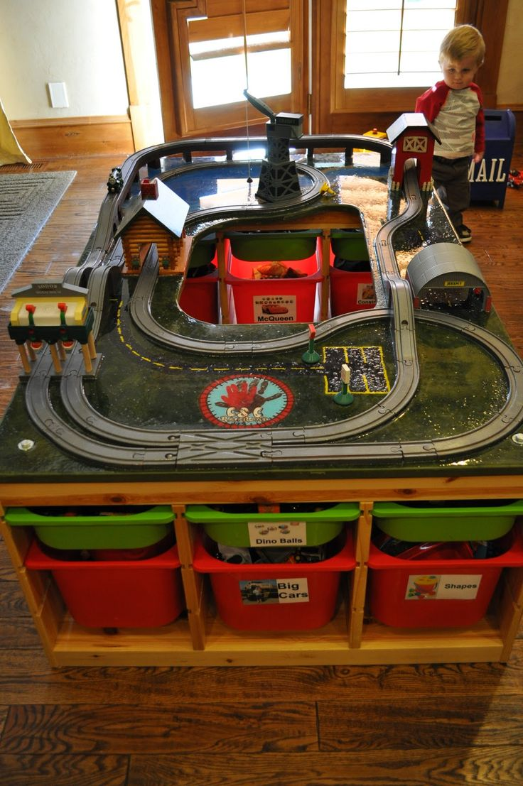 "View #2 -   Home made thomas train table with ikea storage bins as legs...Brilliant...we are in the process of making one for Easton from ""Santa Claus"""
