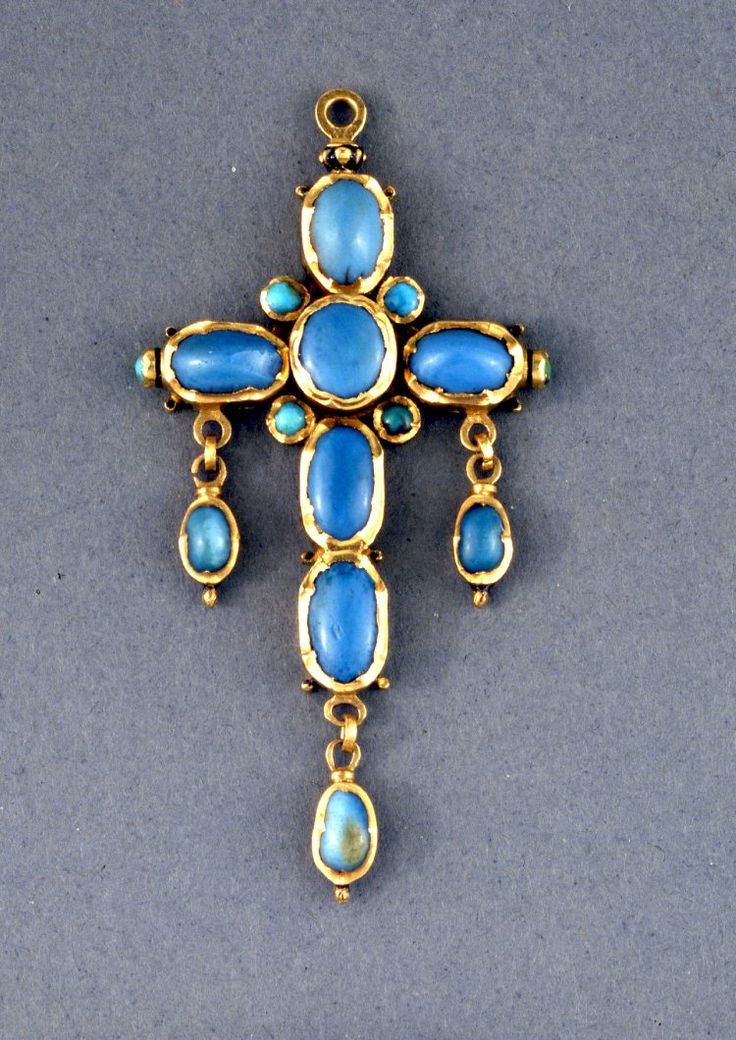 Pendant; cross; gold set with cabochon turquoises; reverse: enamelled with flowers and leaves in red, green and blue translucent enamels en basse-taille; enamel is damaged. Made in England, 16th century