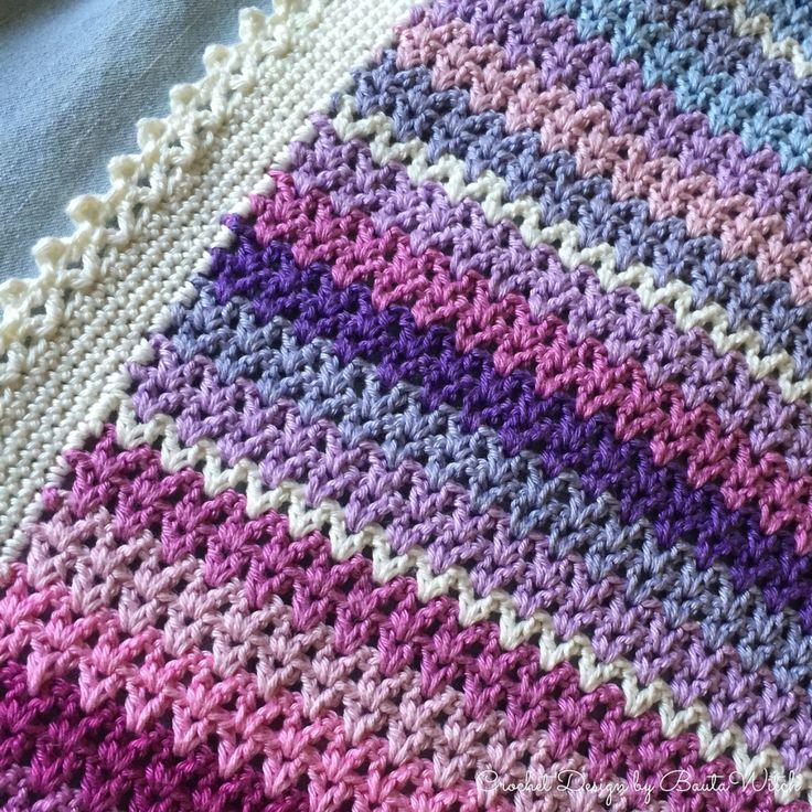 Närbild av färgglad v-stitch pläd by BautaWitch