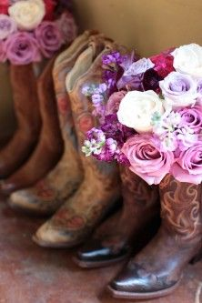 Bridesmaid's bouquets in their boots before wedding for pictures. @Lindsay Sevin