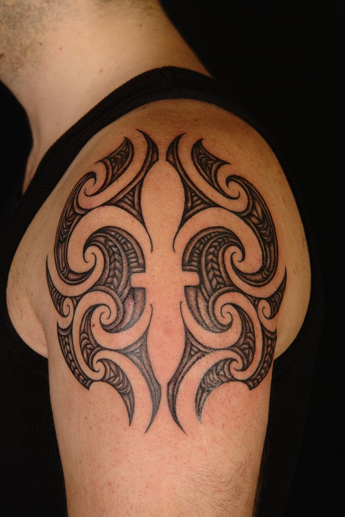 Interesting... Maori style Fleur de Lys. #Tattoo by Shane Gallagher Coley, currently working @ Chapel Tattoo, Melbourne, Australia