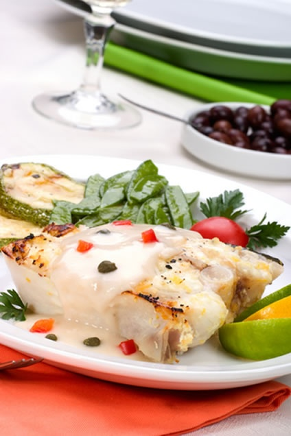 This simple recipe combines grilled halibut filets with a tangy sauce ...