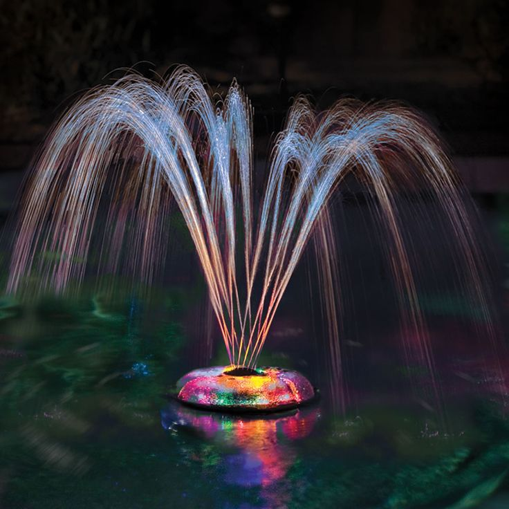 The Floating Light And Water Show - Hammacher Schlemmer - This floating fountain projects colorful spouts of water, turning your pool or pond into an effervescent water and light show.