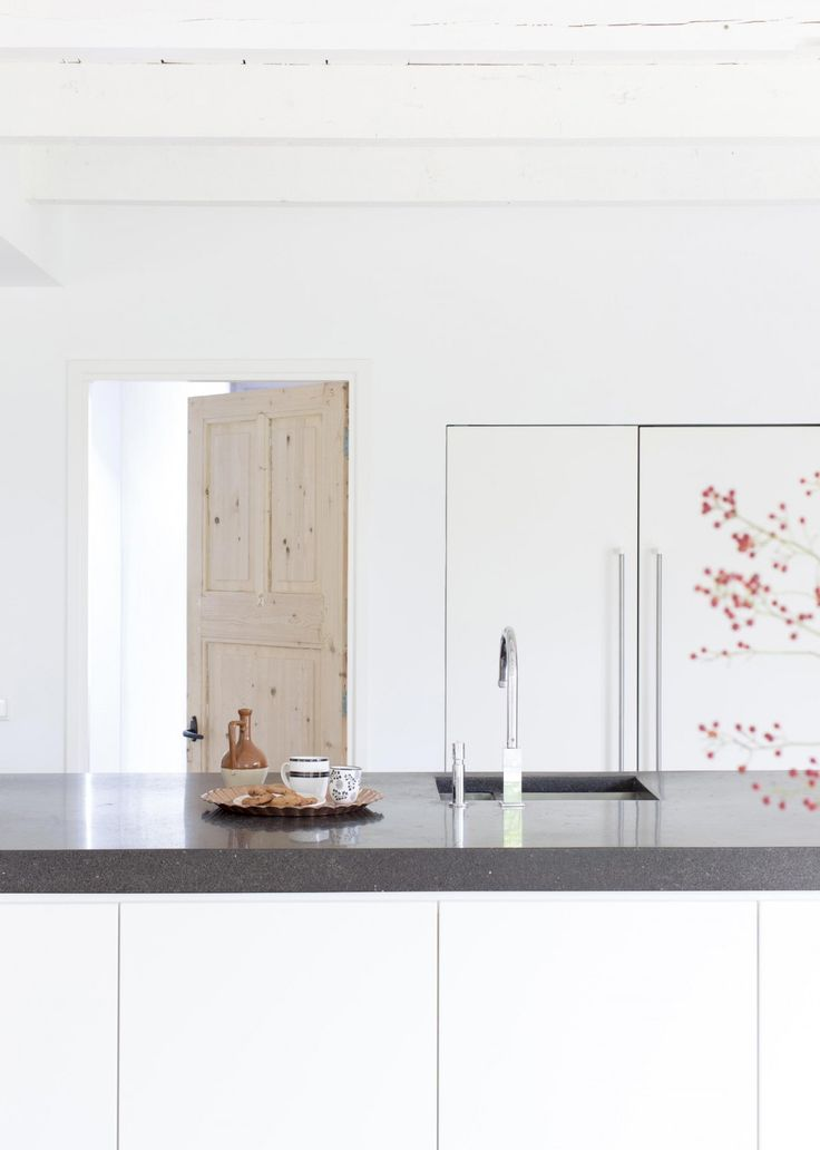 White modern, simple kitchen with touch of black and wood