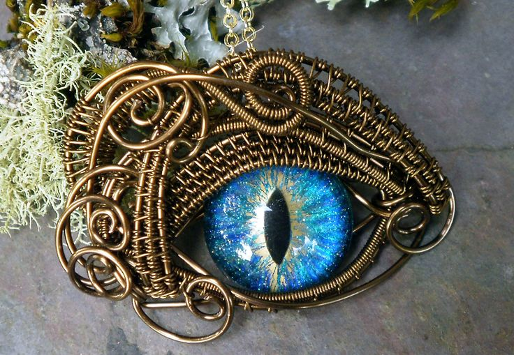 This is amazing wirework  Gothic Steampunk Bronze Evil Eye Pendant Sea Blue and Gold