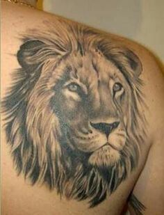 Lion head tattoo on shoulder