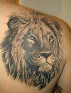 Lion head tattoo on shoulder                                                                                                                                                      More