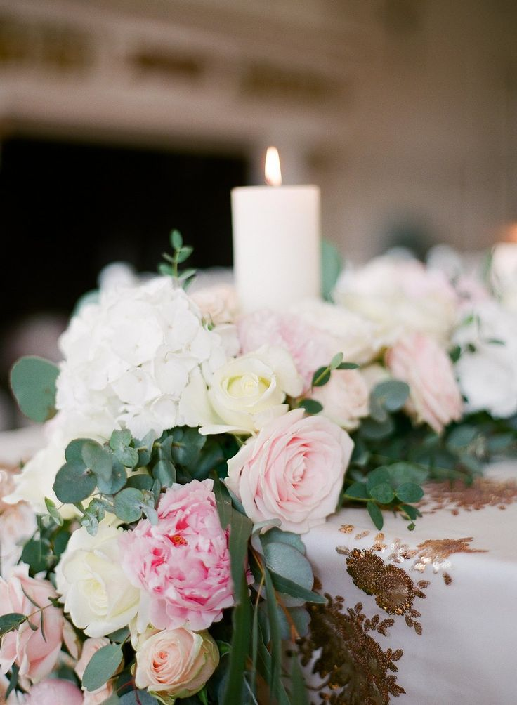 Peony, rose, hydrangea and eucalyptus table runner. Photography by Greg Finck