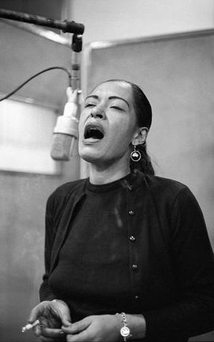 Billie Holiday at work in NY city studio, 1957.