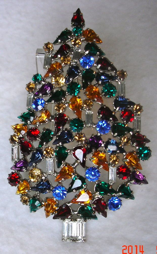 Multi color and multi shape Rhinestone Christmas Tree Pin with nine candles by Butler & Wilson