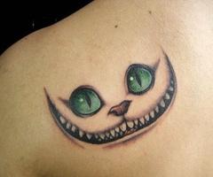 Yeah, i want a creepy cat tatooed on MY shoulder!