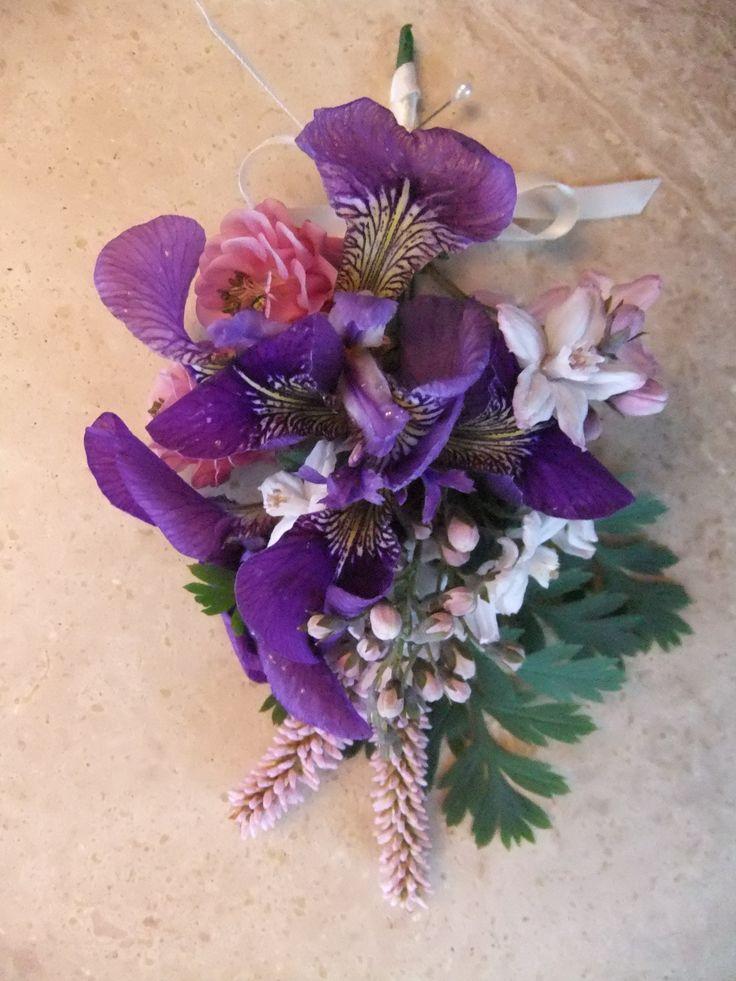 Ladies corsage of iris, polygonum and aquilegia