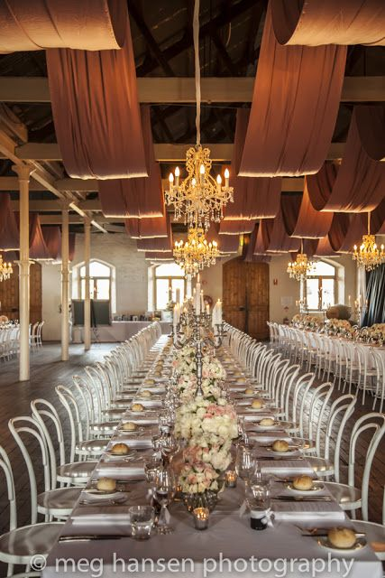 a romantic wedding at chateau tanunda dripping with chandeliers and white bentwood chairs