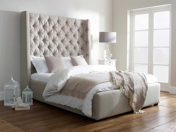 Melt into our Arthur Upholstered Bed, with a bold and tall Buttoned Headboard