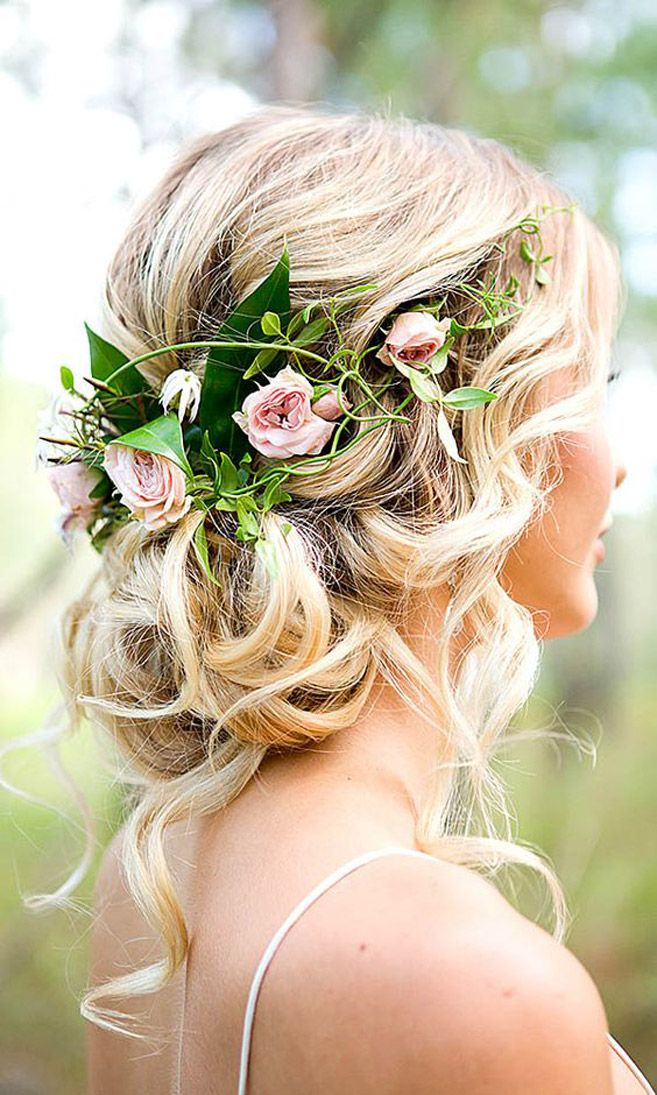 Add pretty pink florals to a messy chignon for an ultra-romantic and feminine look.