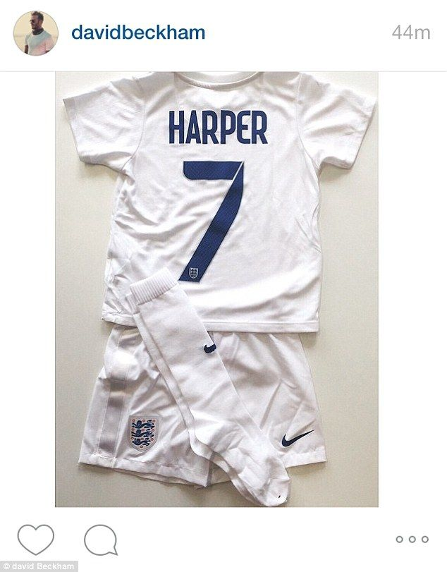 Personalised kit: Harper Beckham has been handed her own mini football kit from the Englan...