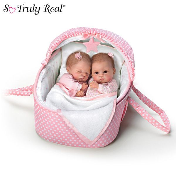 Waltraud Hanl So Truly Real® twin baby girl dolls handcrafted of RealTouch® vinyl and come in a musical bassinet.