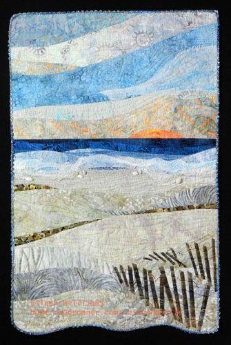 Winter Sunset.  A beachscape art quilt by Eileen Williams