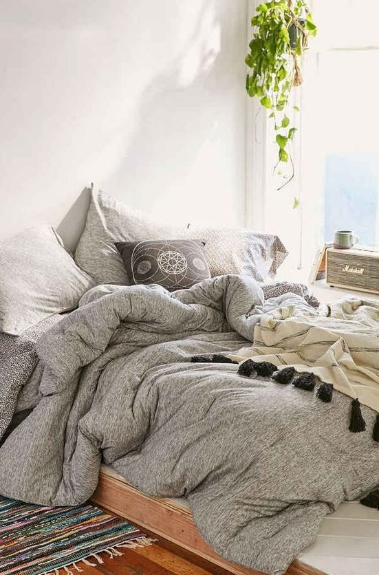 Grey with pops of color is perfect for simple boho dorm rooms!