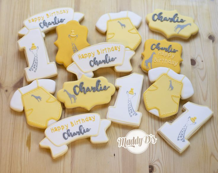 First Birthday Cookies Charlie, one, number one cookie, giraffe, yellow with yellow, grey, gray, white, baby cookies, first birthday, maddy ds, jumper, overalls, coveralls, giraffe in party hat, royal icing, decorated cookies, sugar cookie, dessert, birthday party ideas