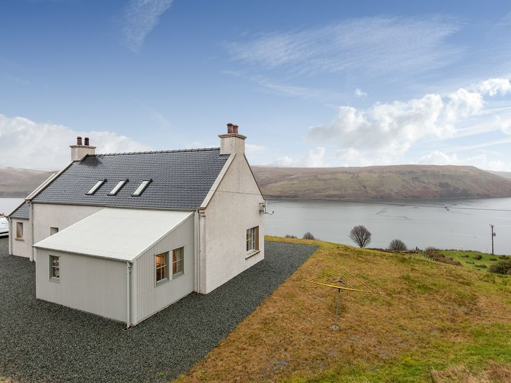 Spend an unforgettable holiday on the stunning Isle of Skye at this architect-designed property, which has loch and mountain views.
