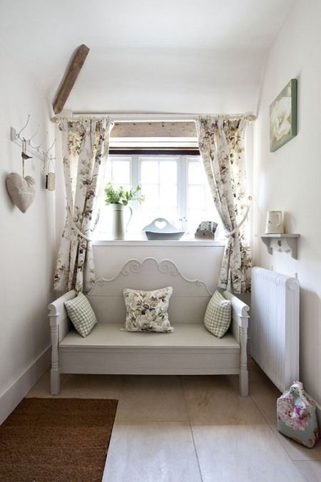 cottage vintage style. I would put some more pillows on this couch for the perfect corner.