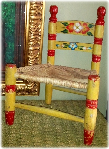 I had one of these painted Mexican children's chairs when I was a kid, except mine was black with red.  ♥♥♥
