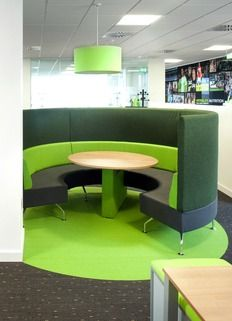 This green curved high backed sofa with central table is ideal for informal meetings with colleagues and provides a space to collaborate outside the open plan workspace.   Herbalife's new office was designed to promote activity so people walk and move about the space, resulting in more 'bump' meetings and a need for a variety of seating areas for people to use.  See a video of this office design by clicking on the image.