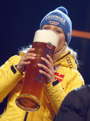A tall, cold one: Germany's Magdalena Neuner at the medal ceremony for the Biathlon World Championships.